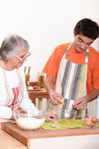 Mother and some baking in kitchen — Stock Photo
