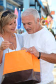 Mature couple looking at a store purchase — Stock Photo