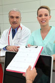 Doctor and nurse receiving medical tests — Stock Photo