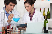 Oenologists working in a lab — Stock Photo