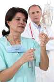 Doctor and nurse with IV drip — Foto Stock