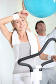 Man and woman at the gym — Stock Photo
