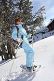 Mature woman having a walk in snowshoes — Stock Photo