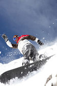 Snowboarder spraying powder — Stock Photo
