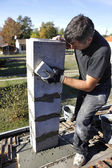 Bricklayer building a post — Stock Photo