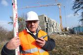 Surveyor on a construction site — Stock Photo