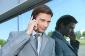 Slick executive using a cellphone — Stock Photo