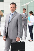 Man with briefcase outside office building — Stock Photo