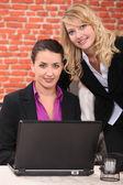 Young women using laptop computer — Stock Photo