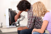 Husband repairing television set — Stock Photo