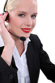 Fair-skinned woman wearing a headset — Stock Photo