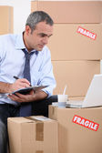 Man searching for new furniture on the internet — Stock Photo