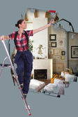 Woman with roller and ladder painting house — Stock Photo