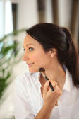 A woman making-up — Stock Photo