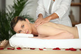 Girl having back massage in beauty parlor — Stock Photo