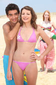 Teenagers larking about on the beach — Foto Stock