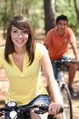 Portrait of young on bikes — Stock Photo
