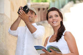 Tourists photographing monuments — Stock Photo