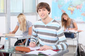 Teenage students working in classroom — Stock Photo