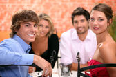 Family sat in restaurant — Stock Photo