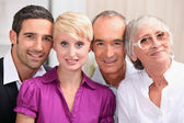 60 years old man and woman posing with 30 years old man and woman — Stock Photo