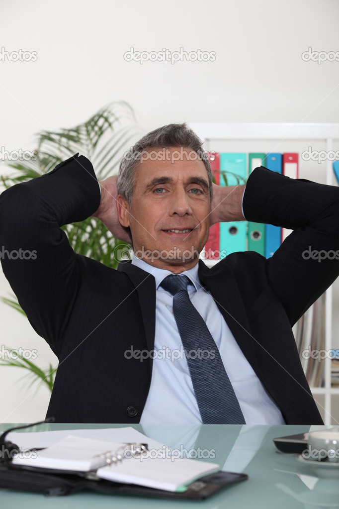 Portrait of an arrogant businessman with his hands behind his head — Stock Photo #7790031