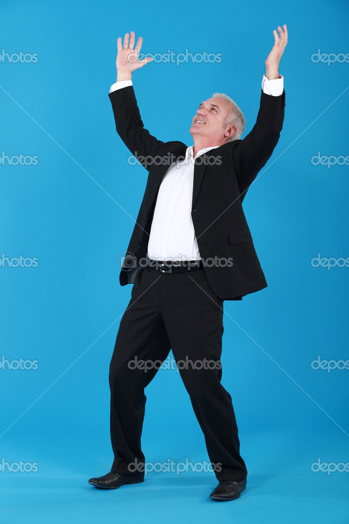 A victorious businessman.  Stock Photo #7790361