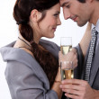 Elegant young couple drinking champagne — Stockfoto