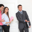 Promoter and young couple visiting a flat — Stock Photo #7800141