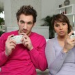 Young couple playing computer games — Foto Stock