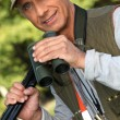 Stock Photo: Hunter with his binoculars