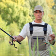 Stock Photo: Freshwater fisherman