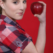 Woman with a red apple — Stock Photo