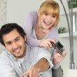 Young woman and young man playing video games — Stock Photo