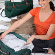 Young wompreparing travel bag — Stock Photo #7800807