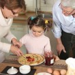Family preparing pancakes — Stock Photo