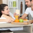 Royalty-Free Stock Photo: Couple enjoying romantic meal in bedroom
