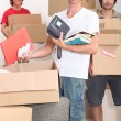 Foto de Stock  : Lads packing boxes