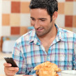 Texting over breakfast — Stock Photo #7801661
