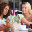 Womexamining their purchases — Stock Photo #7801741