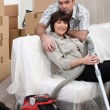 Couple vacuuming house before moving — Stock Photo #7801871