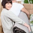 Stock Photo: Couple carrying rug