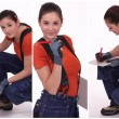 Young craftswoman wearing blue trousers - Stock Photo