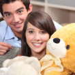 Royalty-Free Stock Photo: Teenagers with a teddy bear