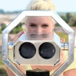 Stock Photo: Portrait of wombehind binoculars