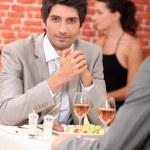 Men eating in a restaurant — Stock Photo