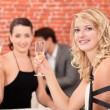 Two girlfriends drinking wine in a restaurant — Stock Photo