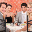 Group of friends at the restaurant — Stock Photo