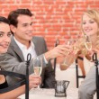 Stock Photo: Foursome in restaurant
