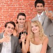 Co-workers celebrating - Stock Photo
